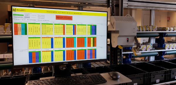 transtockeur et gestion automatisée de commandes en industrie pharmaceutique